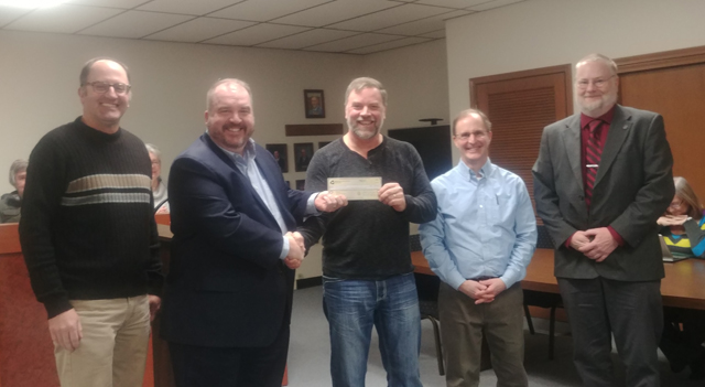 Harrisonville City officials accept a grant from M0PEP.