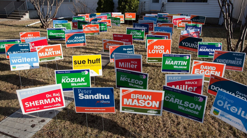 Several signs in a yard.
