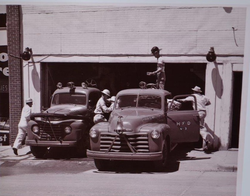 Older image of the Fire Fighters Working on Vehicles at the Fire Station